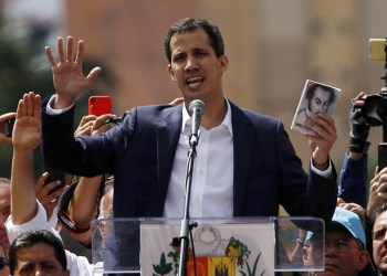 Juan Guaidó, head of Venezuela's opposition-run congress, declares himself interim president of Venezuela during a rally against President Nicolás Maduro in Caracas on Wednesda