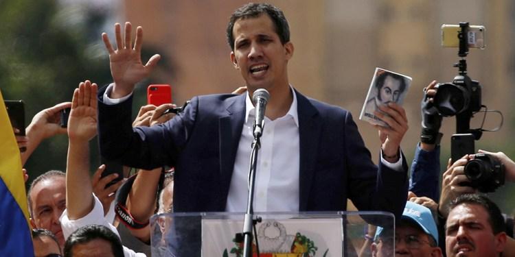 Juan Guaidó, head of Venezuela's opposition-run congress, declares himself interim president of Venezuela during a rally against President Nicolás Maduro in Caracas on Wednesda