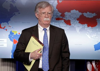 National security adviser John Bolton listens during a press briefing at the White House, Monday, Jan. 28, 2019, in Washington. (AP Photo/ Evan Vucci)