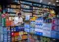 In this picture taken on September 22, 2016, a salesman uses his phone in a Chinese and western pharmacy in Hong Kong. / AFP / Anthony WALLACE (Photo credit should read ANTHONY WALLACE/AFP/Getty Images)