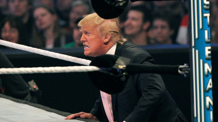 DETROIT - APRIL 1: Donald Trump icheers on his fighter n the Battle of the Billionaires at the 2007 World Wrestling Entertainment's Wrestlemania April 1, 2007 at Ford Field in Detroit, Michigan. The event drew more than 80,000 wrestling fans. (Photo by Bill Pugliano/Getty Images)