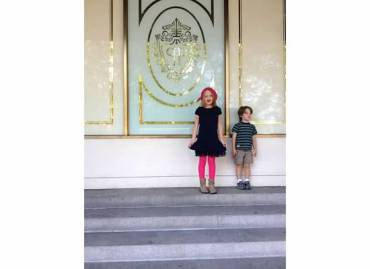 The kiddos in front of The Plaza