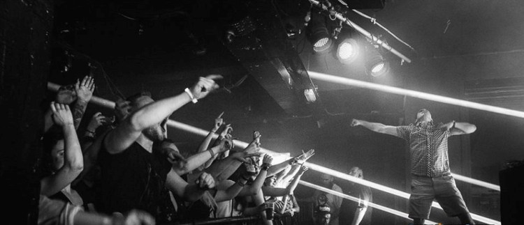 enter shikari performing on stage at cathouse rock club with crowd of fans singing and dancing behind railing