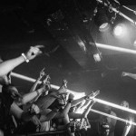gigs - enter shikari on stage at cathouse rock club with crowd dancing and singing in black and white