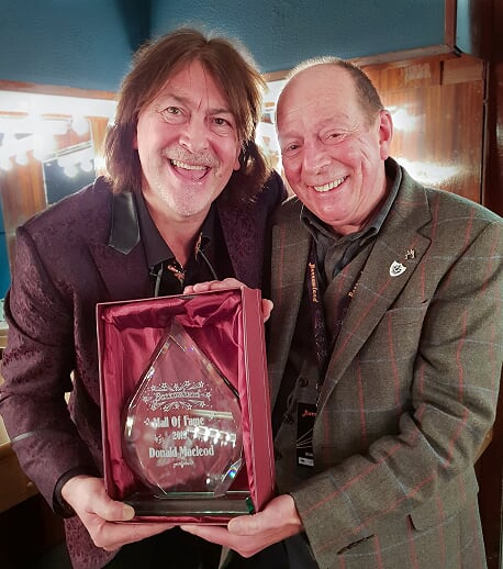 Donald with Tom Joyes backstage at Barrowland Ballroom Glasgow with Donald's Barrowland Hall of Fame 2019 award