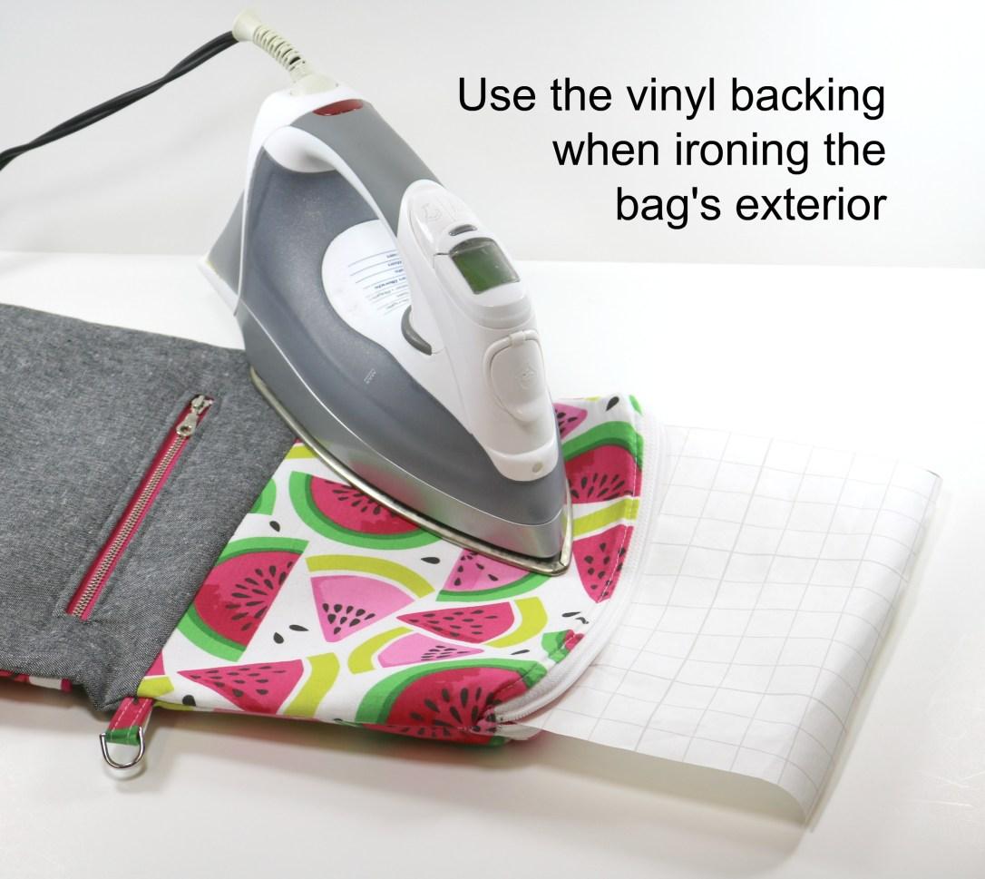 17 - Insert vinyl backing into zip pocket when pressing exterior.jpg