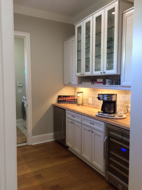 We added butler's pantry/bar area in empty room off kitchen