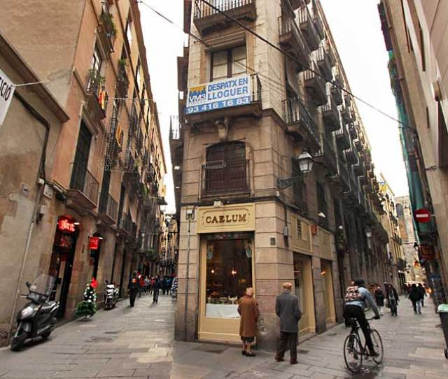 Narrow Lanes And Unique Shops In The Gothic Quarter Of Barcelona Spain