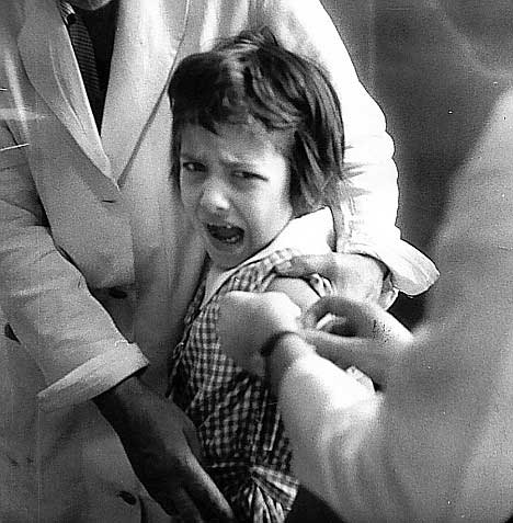 Distressed child receives a vaccination