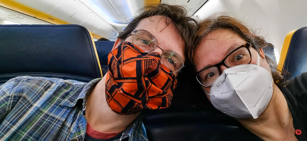 Wearing a face mask on board a Ryanair flight while flying in Europe during COVID-19
