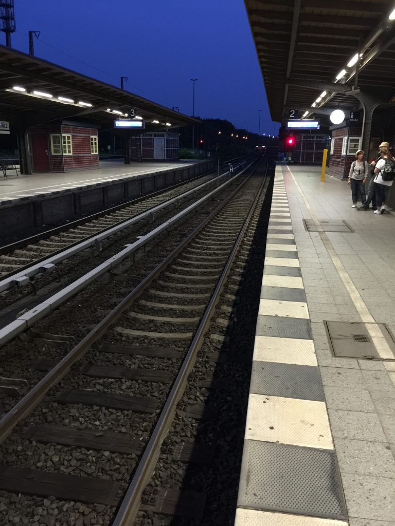 Waiting for a train at the station. Trains are a good way to travel