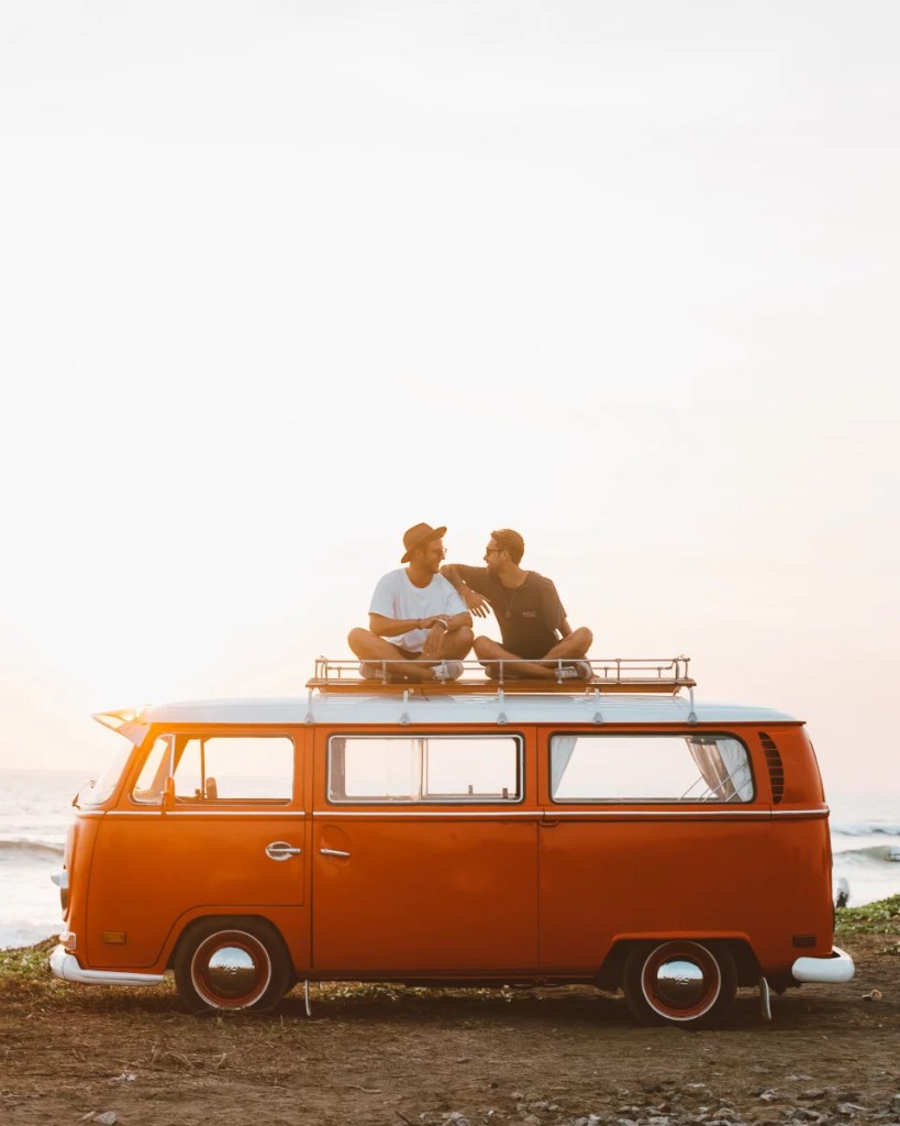 Traveling Veterinarian and Partner on a classic van