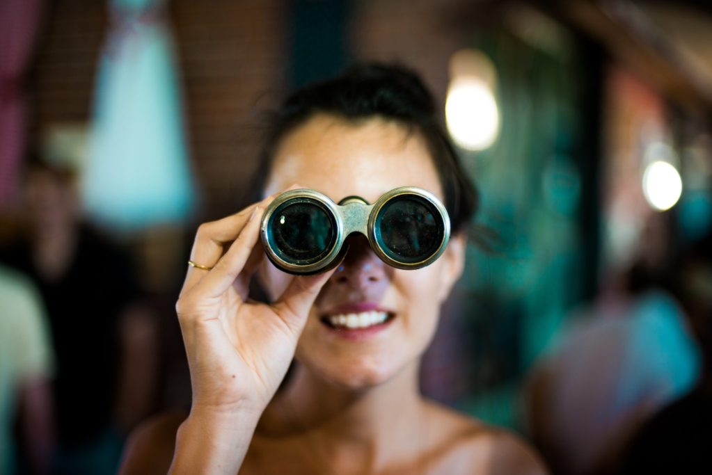 customer empathy; woman using binoculars by Chase Clark https://unsplash.com/@chaseelliottclark?utm_medium=referral&utm_campaign=photographer-credit&utm_content=creditBadge