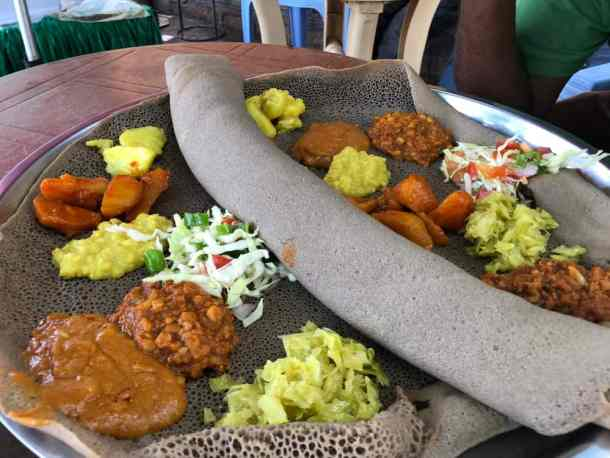 injera teff flatbread with curries