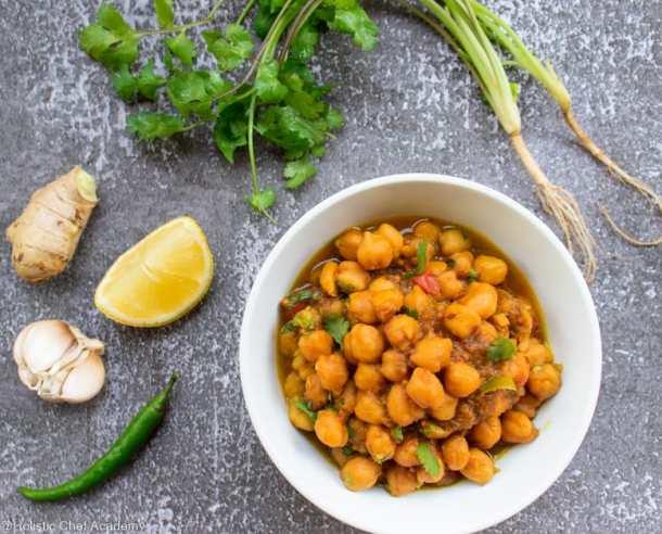 chickpea chana masala garnished with chopped coriander