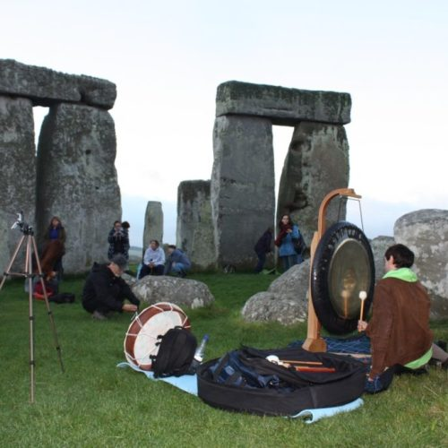 Gary Evans playing the gong inside Stonehenge