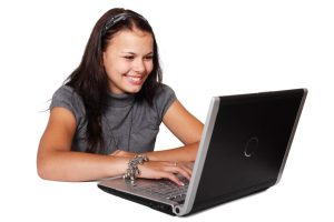 a young woman working on computer