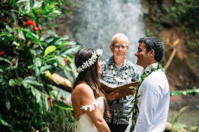 A young bride and groom having a wedding ceremony in Kauai.