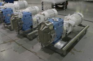 Waukesha U2 Pumps Mounted on Polished Round Tube Bases