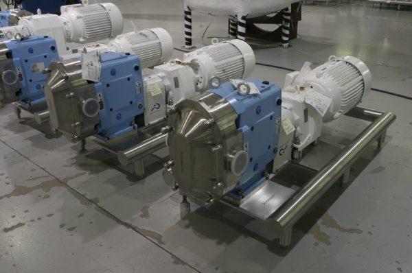 Waukesha U2 Pumps Mounted on Polished Round Tube Bases with Adjustable Feet