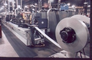 Stainless Steel Strip being  Fed into a Tube Mill