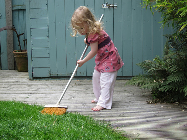 Flora sweeps the lawn