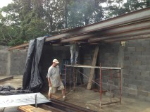Scotts working on his wood storage area