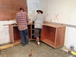 Scott and Richie installing kitchen cabinets