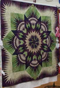 Susie's Prairie Star (quiltworx.com pattern) - yes there is a ribbon on the right side!