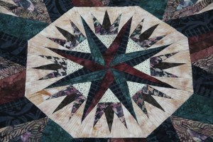 "The center of the quilt, this unit is called ""Compass Rose"""