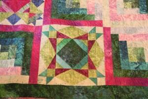 Custom freehand quilting in the sampler blocks