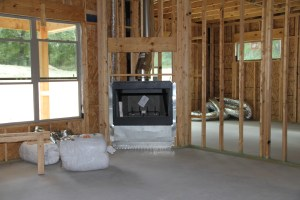 When we started designing the great room, we tried moving the fireplace all around the room - only to end up with with it where it was to begin with.  This will be all rock with a nice size hearth.
