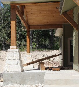 I love the rock columns with the cedar posts and ceiling - I think we will spend a lot of time on this back porch