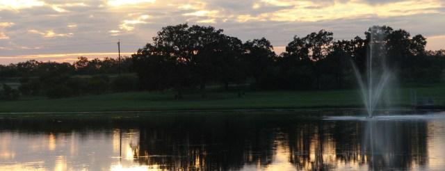 Sun setting over the lake - photo 1