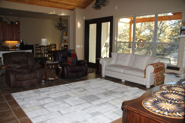 Found this rug at Sam's, it goes really well with our stone work around the fireplace and my white couch!  Who buys a white couch?  This furniture is 25 years old and still almost like new because we never use it because - well - it's white!