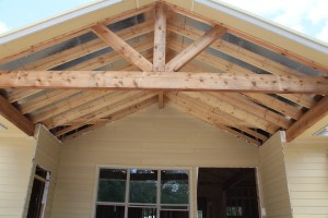The back porch trusses, cedar ceiling goes up next week
