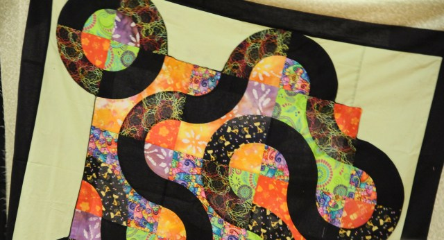 What a fun quilting - I LOVE the colors!  Fabulous motion happening here too!