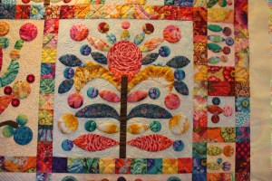 Be sure to look how Karla used the various Kaffe fabrics for her leaves and lollipops.