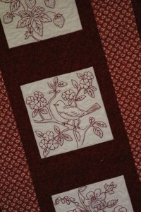 This redwork was done by one guild member and another guild member made the quilt. Exquisite needle work on the redwork.