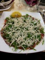Beef carpaccio with rocket, parmigiano reggiano and lemon