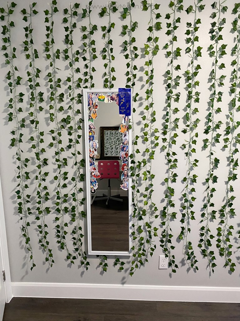 Artificial vine wall with Billie Eilish stickers.