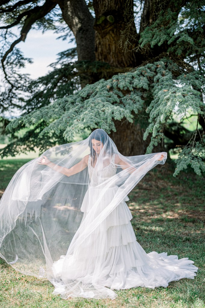 bride in cathedral length veil Holly Winter Couture