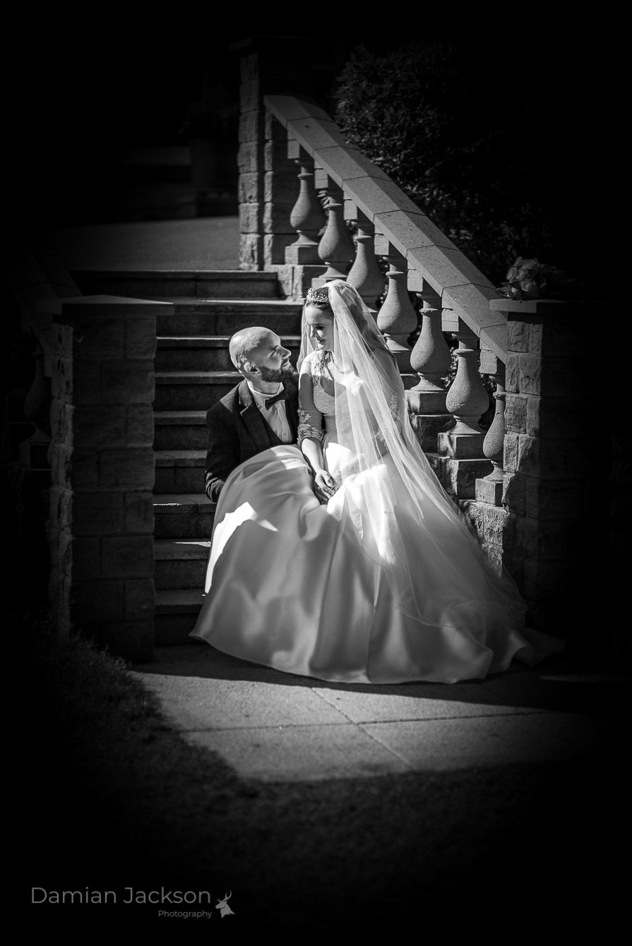 Real bride and groom with bespoke embroidered veil by Holly Winter Couture