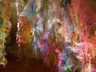 """""""Mind/Forest I"""" (Right Side) 2018, Polyester tulle, produce netting, thread, duralene plastic, plastic rope, and cotton gauze, 13'L x 18'W x 9'H."""