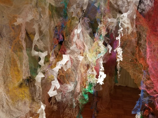 """""""Mind/Forest I"""" (Left Side) 2018, Polyester tulle, produce netting, thread, duralene plastic, plastic rope, and cotton gauze, 13'L x 18'W x 9'H."""