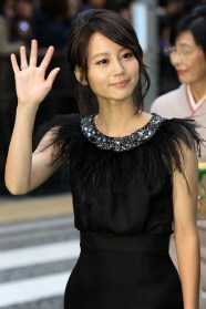 Fashion model and television and film actress, Maki Horikita waves to her fans at TIFF.