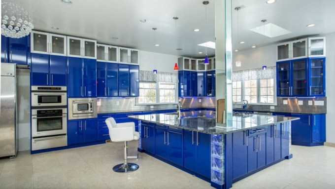 Bright Glossy Blue Accents in Such Large Kitchen