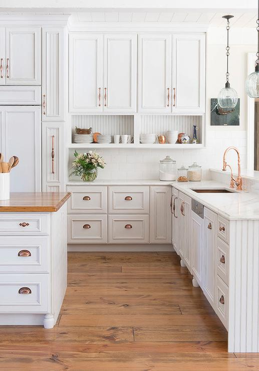 White Kitchen Cabinet with Copper Accents
