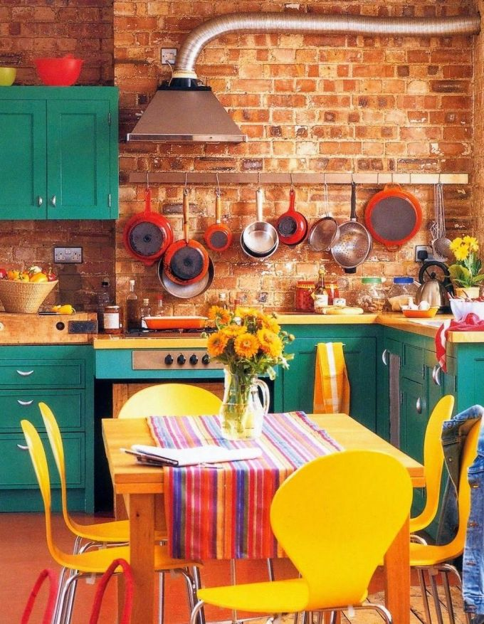 Yellow and Orange Kitchen with Teal Cabinet