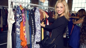 An excited shopper is all smiles as she checks out the designer bargains